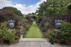 English country garden borders. English country garden, Gloucestershire, England stock image