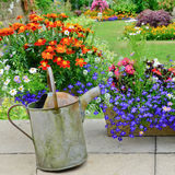 English country garden. Typical english county garden in full bloom in summertime stock photos