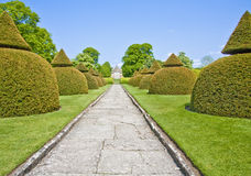 English country home in somerset. Country home and crazy paved footpath through ornamental trees and lawned gardens Royalty Free Stock Photo
