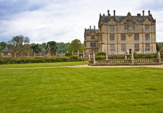 English country home in somerset. Country home surrounded by neatly cut lawns approached by gravel drive Stock Photos