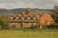 English Country House. Red Brick House with gables and chimneys in English countryside Royalty Free Stock Photos