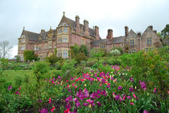 English Country House, Devon. Typical English Country House facade with spring flowers in full bloom. English stately homes are popular with gardeners and royalty free stock photo