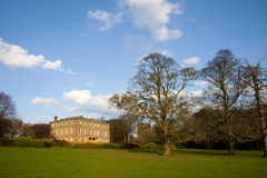 English Country House in a Park. Beautiful English Country House in Parkland Stock Image
