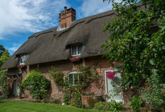English country house with thatch roof Royalty Free Stock Image
