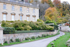 English Country Lane and Manor House Stock Photo
