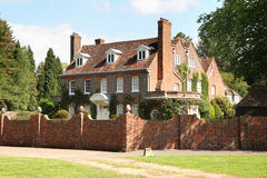 English Country Manor House. Surrounded by a high red brick wall Stock Photography