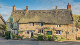 English Country Pub. A typical English country pub with a thatched roof royalty free stock images