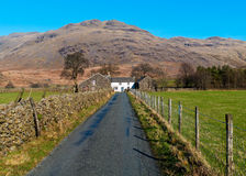 English country road and cottage Stock Images