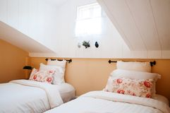English country vintage attic bedroom interior with natural ligh Royalty Free Stock Image