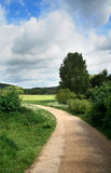 English Countryside. An English Rural Scene with a track leading into fields and meadows Royalty Free Stock Photography