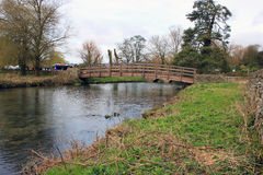 English countryside footbridge in the cotswolds. Small english village footbridge landscape Royalty Free Stock Images