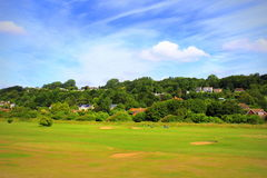 English countryside golf course view Hythe Kent UK. Senior people playing golf on a golf course set in an area of outstanding natural beauty.Hythe town Kent Royalty Free Stock Photo