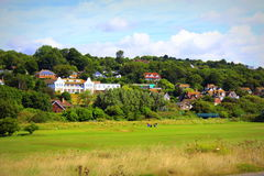 English countryside golf course view Hythe Kent UK. Senior people playing golf on a golf course set in an area of outstanding natural beauty.Hythe town Kent Royalty Free Stock Images