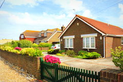 English countryside houses Kent United Kingdom. New residential bungalows in Lydd-on-Sea village.Lydd-on-Sea is a modern village, mostly built after World War II Stock Image