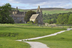English countryside landscape: Bolton Abbey view. English countryside landscape with a footpath leading to Bolton Abbey ruins, Yorkshire Dales, surrounded by Royalty Free Stock Images