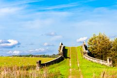 English countryside landscape. With grazing sheep and old bridge Stock Images