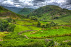 English countryside scene the Lake District with valley and mountains and green fields in HDR. English countryside scene the Lake District Martindale Valley near Royalty Free Stock Images