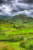 English countryside scene the Lake District with valley and mountains and green fields in HDR. English countryside scene the Lake District Martindale Valley near Royalty Free Stock Image