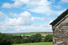 English countryside. Typical English countryside, with stone shed and fence in foreground Stock Images