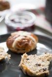 English cream tea, fresh scones. Fresh cross buns for breakfast on table Stock Images