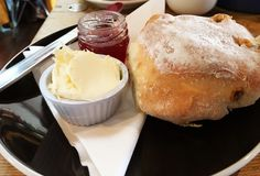 English cream tea. Typical cream tea from Devon. Clotted cream , strawberry jam and scone Stock Photo