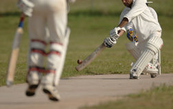English Cricket Match. Swinging stock photos