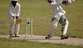 English Cricket Match. Hitting the wickets royalty free stock photography