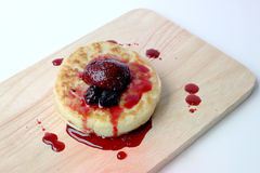 English Crumpets & Berry Topping on wood board isolate on white background Stock Images