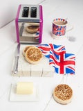 English crumpets with butter Stock Photography