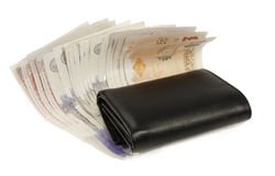 English currency and wallet. English bank notes under a black wallet Stock Images