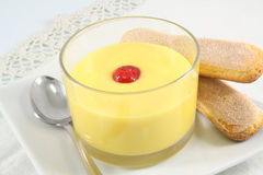 Custard with cherry and cookies Royalty Free Stock Images