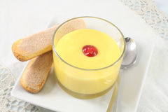 Custard with cherry and cookies Stock Photos