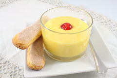 Custard with cherry and cookies Royalty Free Stock Photos