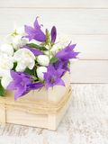 English dogwood and bellflowers bouquet in the wooden box Royalty Free Stock Photography