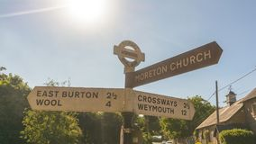 English Dorset Road Name Direction Sign C. East Burton, Wool, Moreton Church, Crossways, Weymouth stock photos