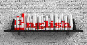 English. Education Concept. English - Red Inscription on the Books on Shelf on the White Brick Wall Background. Education Concept Stock Photo