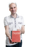 English education. Happy casual man with book Royalty Free Stock Photo