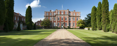 English Estate Chicheley Hall. Formal, old English country estate, Chicheley Hall, Newport Pagnell, United Kingdom.  Authentic early Georgian architecture, wide Royalty Free Stock Photo