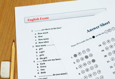 English exam on table. English exam on wooden table Stock Image