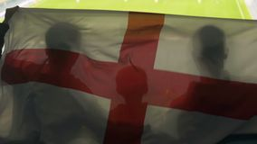 English fan family with kid waving national flag, cheering for football team. Stock footage stock video footage