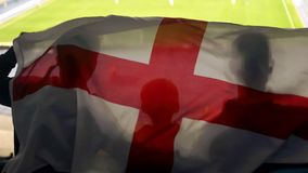 English fan family with kid waving national flag, cheering for football team. Stock photo stock photo