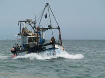 English fishing boat. Preparing to launch the Royalty Free Stock Images