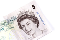 English five pound note. On white back ground royalty free stock image