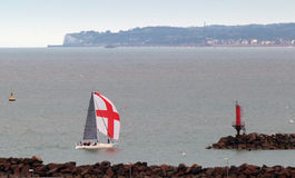 English Flag Boat in the harbour. A boat with an English flag coming into the harbour Royalty Free Stock Image