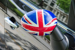 English flag on the mirror of shiny black car Stock Photo