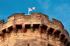 English flag on a pole top of medieval castle tower Royalty Free Stock Photos