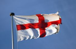 English Flag, St George Cross. The Cross of St George shot in evening sunlight (very windy so some motion blur royalty free stock photos