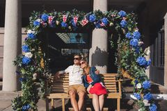 Couple in love seated on a swinging bench in covent garden London stock photography