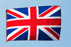 English flag in the wind against a blue sky Stock Photo