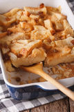 English food: bread pudding close up in baking dish. vertical Stock Images
